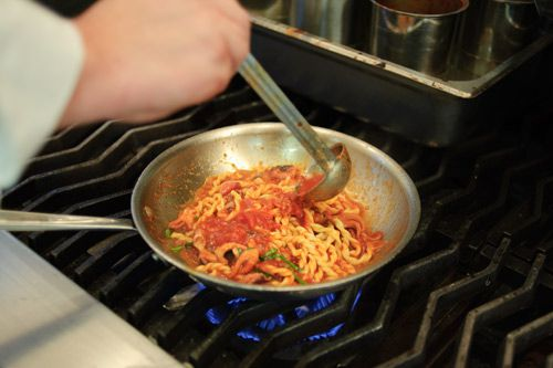 2009-7-11-Marea-adding-sauce.jpg