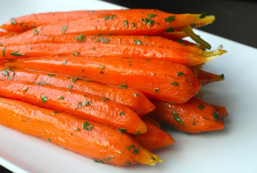 Whole carrots cooked sous vide and tossed with herbs.