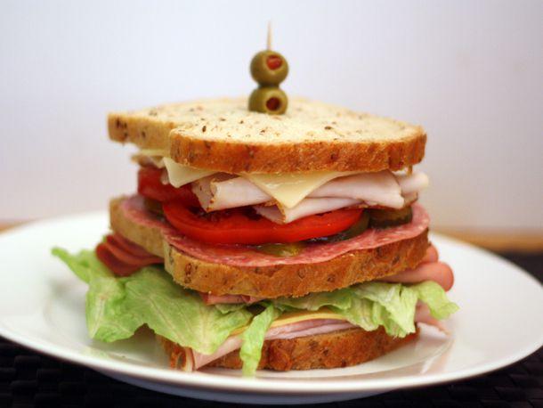 Dagwood sandwich on a plate.