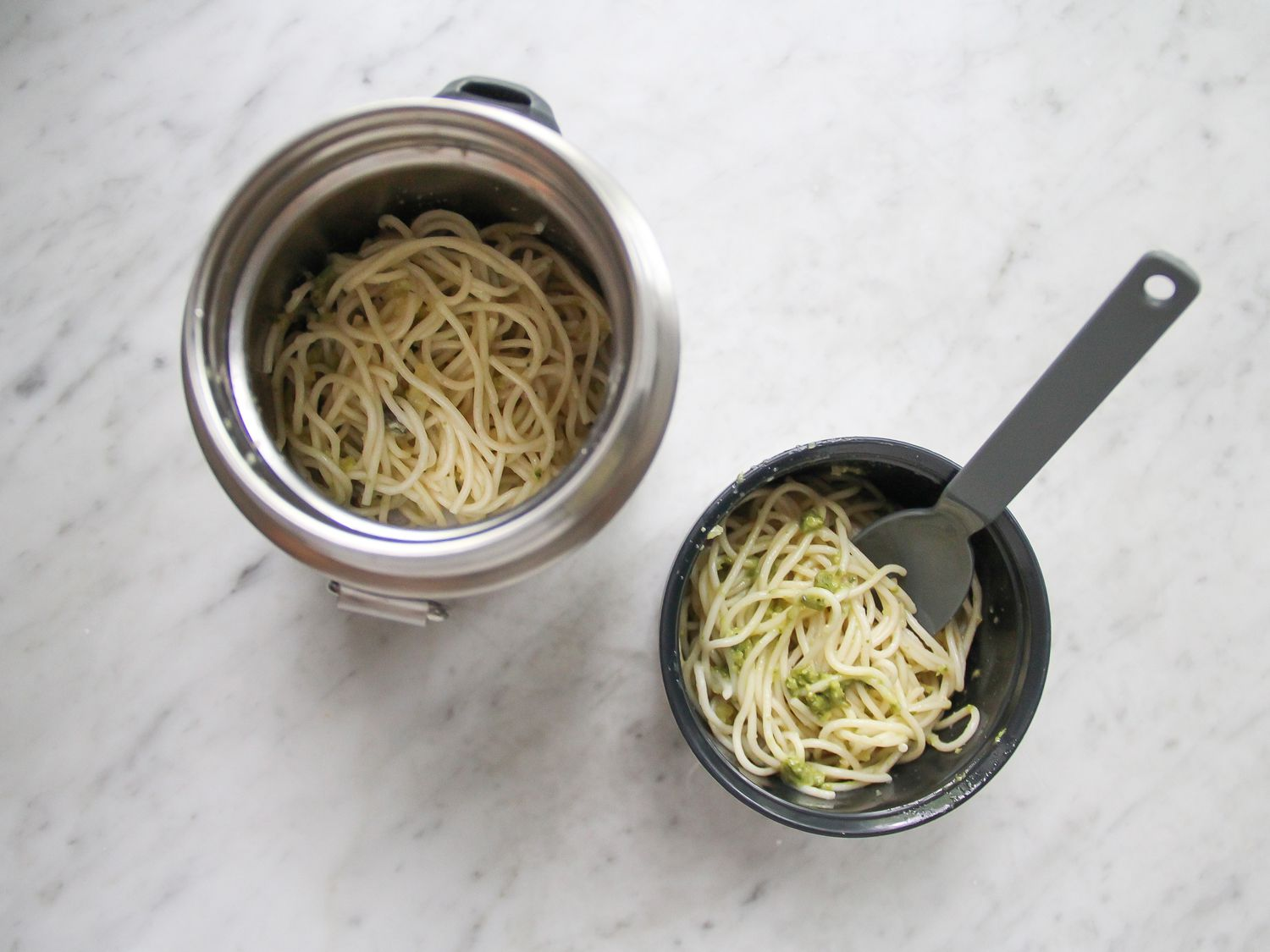 Food thermos with pasta and spork