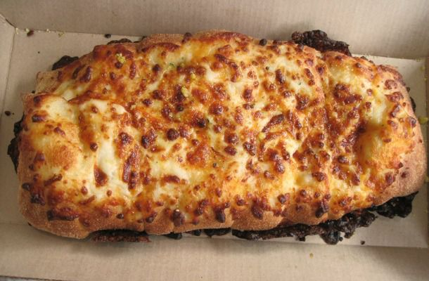 20111214-chain-reaction-dominos-cheesy-bread-primary.jpg