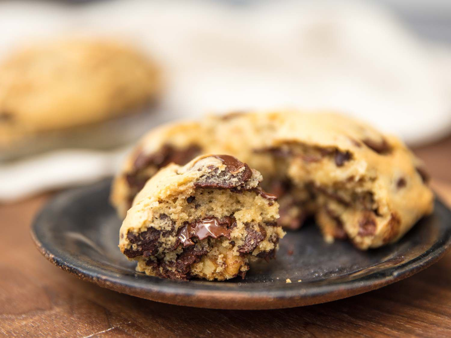 Levain Bakery-style super thick chocolate chip cookie on a plate.