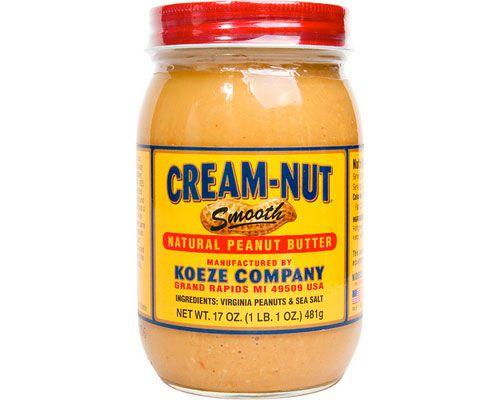 A jar of Cream-Nut Smooth peanut butter.