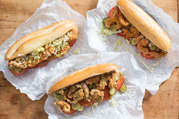 Shrimp, Oyster, and Fish Po' Boy sandwiches on sandwich paper