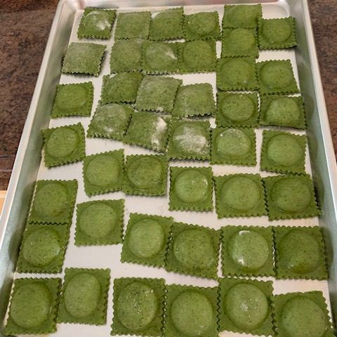 overhead view of tray of spinach ravioli