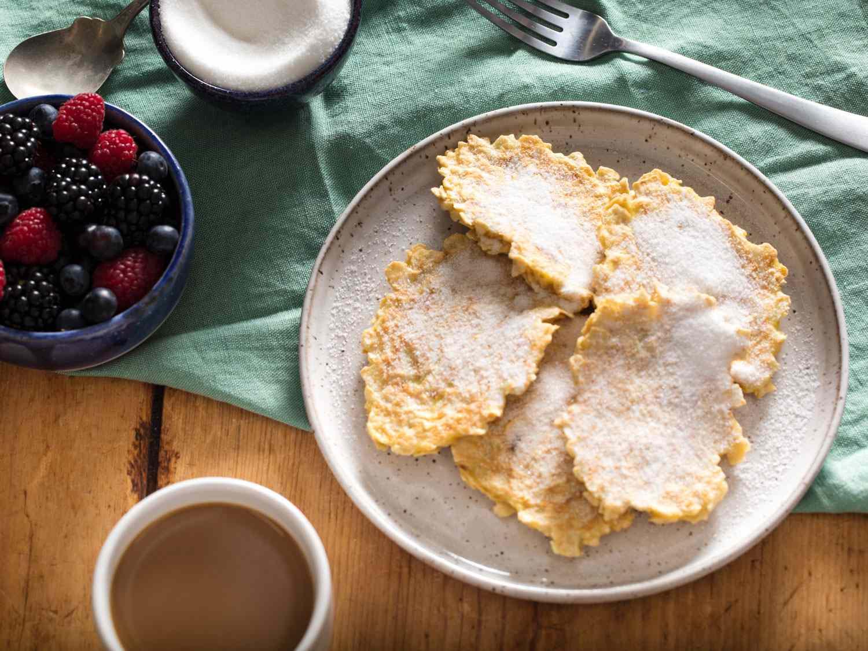 A plate of chremslach, matzo brei pancakes with sugar
