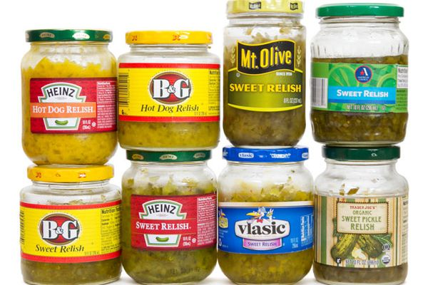 Eight pickle relishes in jars.