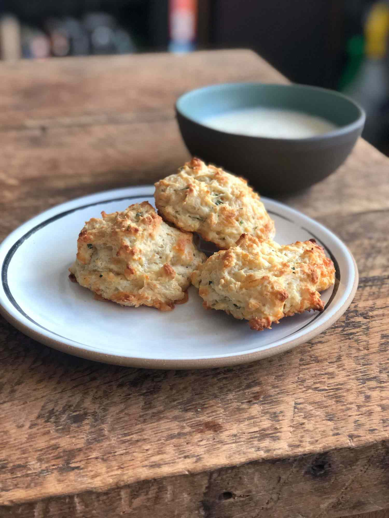 Plate of cheddar drop biscuits on a table