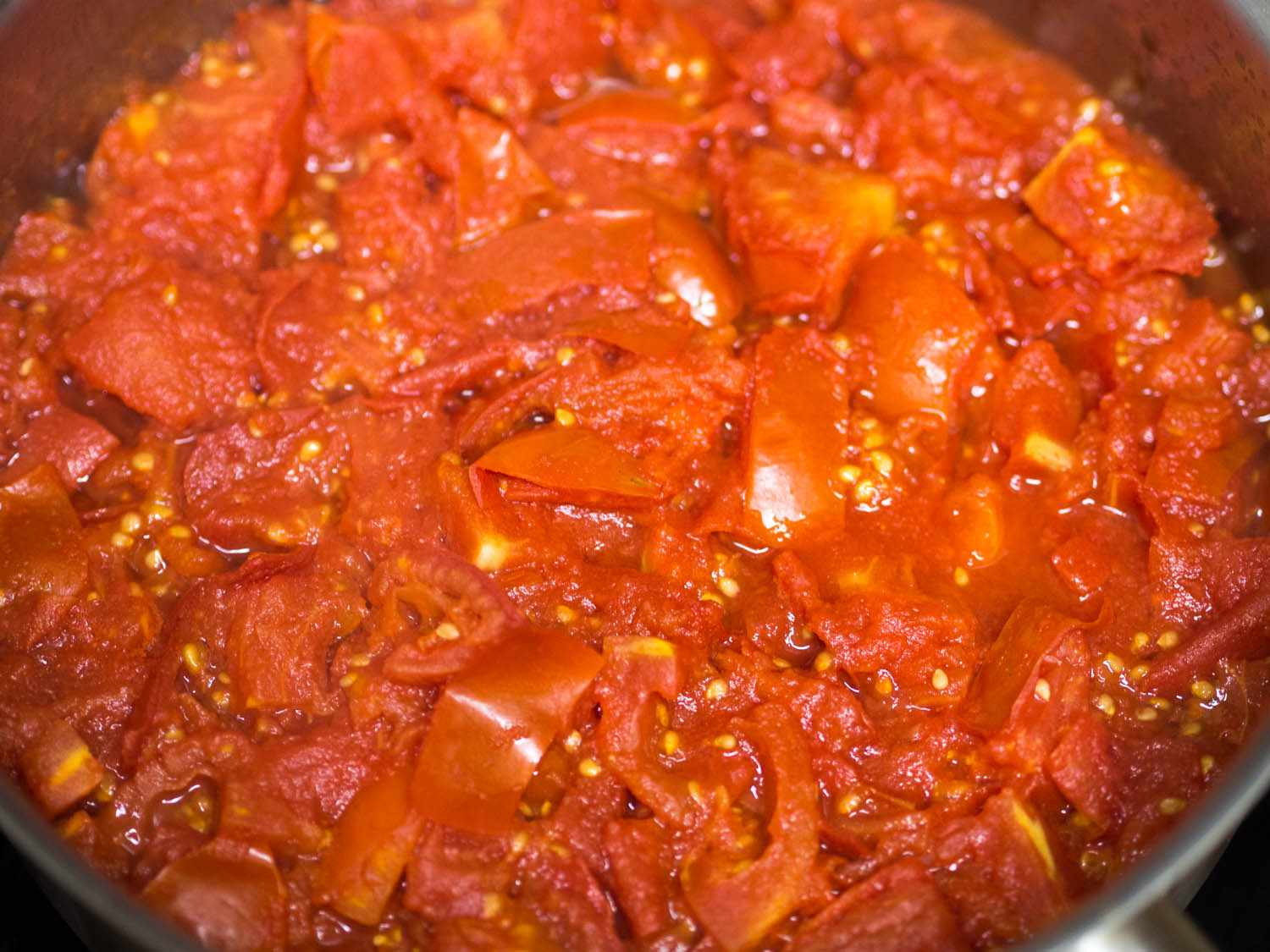 A pot of chopped up Amish paste tomatoes.