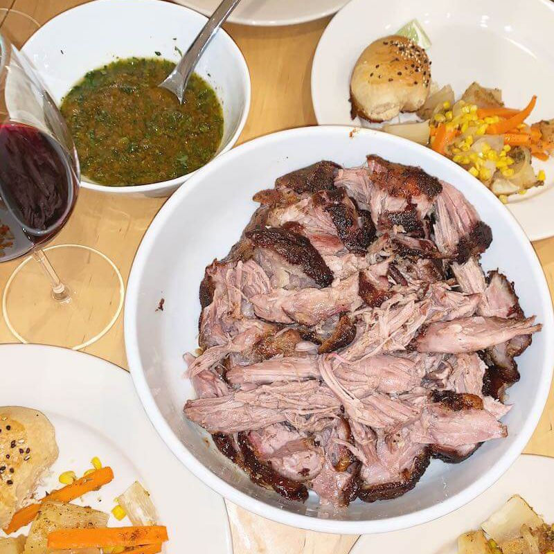 Overhead view of shredded cuban-style marinated and roasted pork with fixings alongside