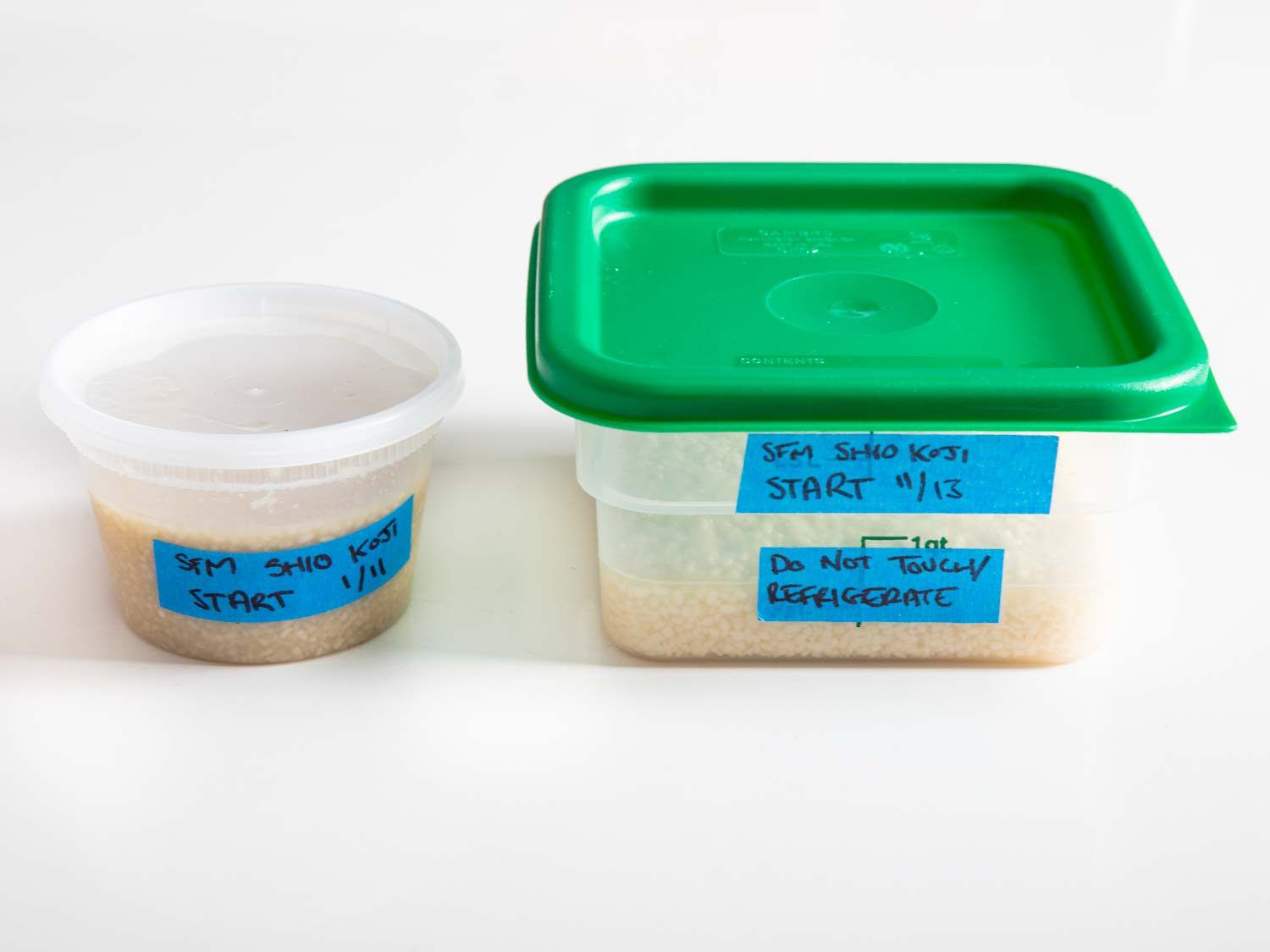 Side view closeup of two containers of shio koji.