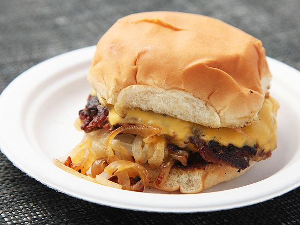 onion cheeseburger on paper plate