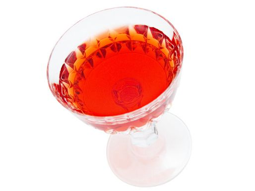 Eeyore's Requiem cocktail in a stylized coupe glass on a white backround.