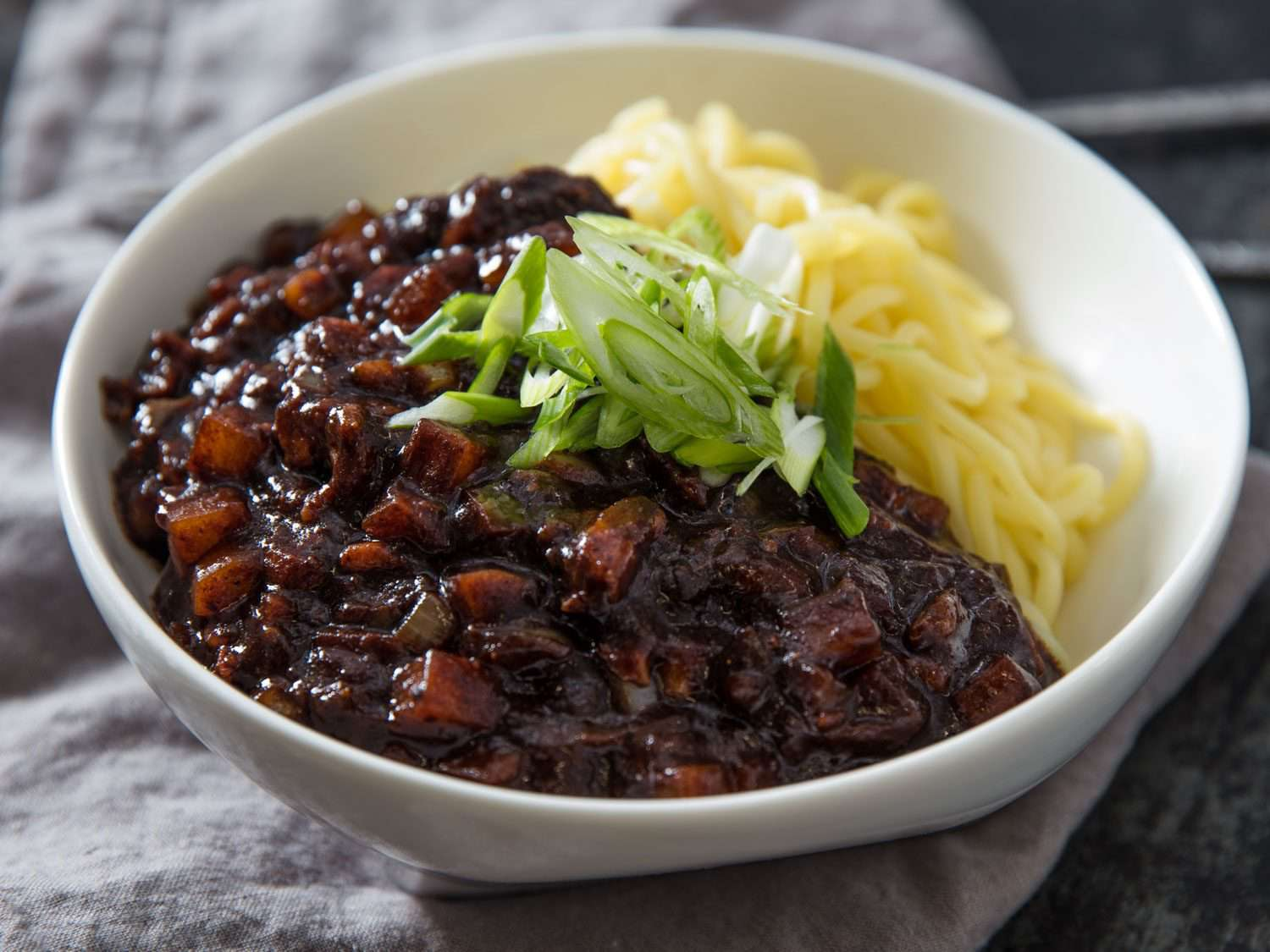 Close-up of a bowl of jjajangmyeon (wheat noodles with black bean sauce)