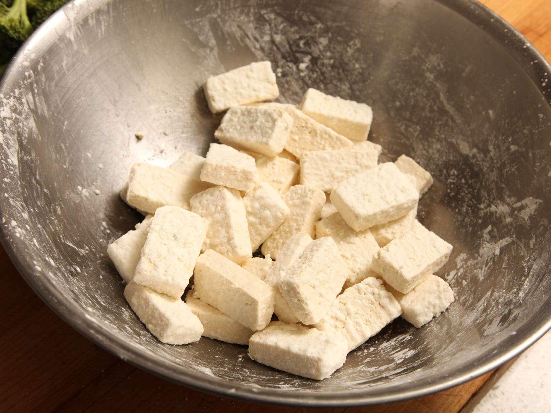 Tofu slices tossed in cornstarch.