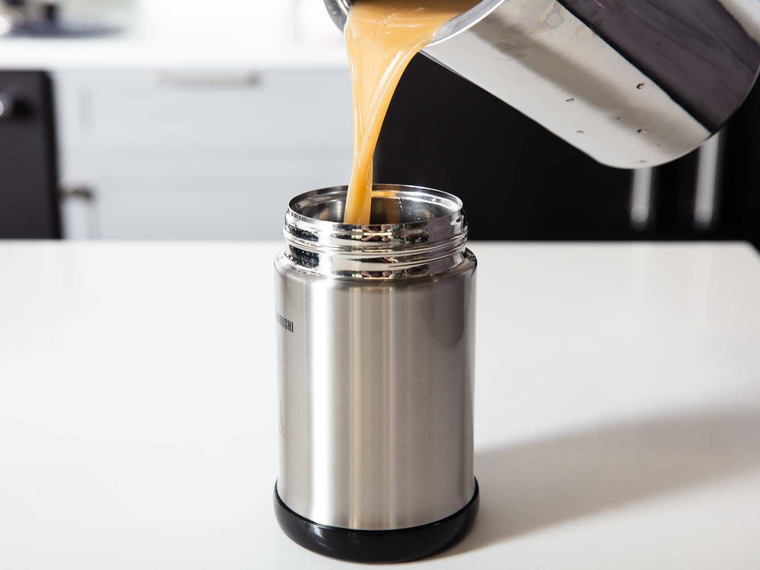 Pouring gravy into an insulated thermos