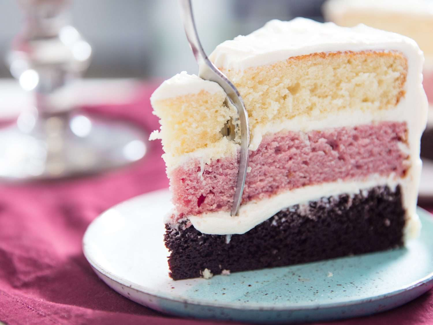 slice of Neapolitan layer cake with a fork