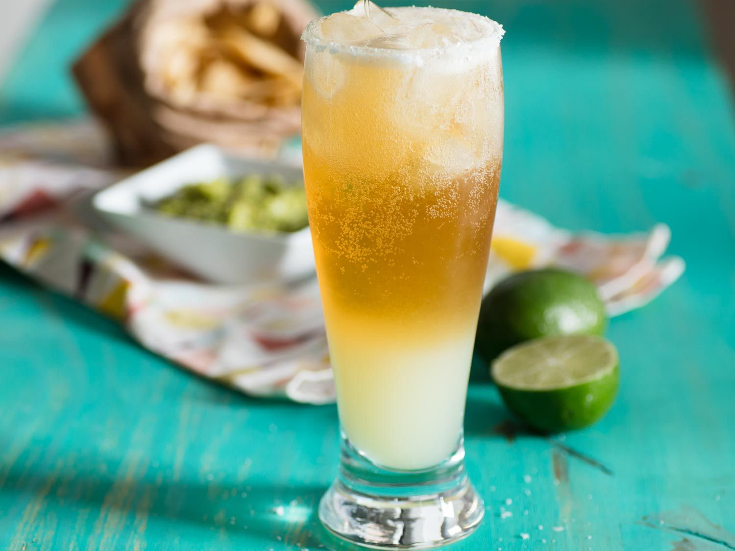 A chelada (lime juice, beer, and salt over ice) in a tall glass