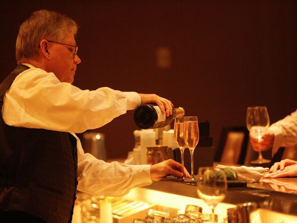 bartender pouring champagne