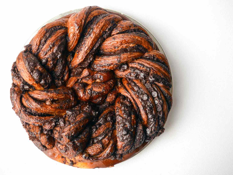 Overhead photo of circular, intricately braided chocolate babka.