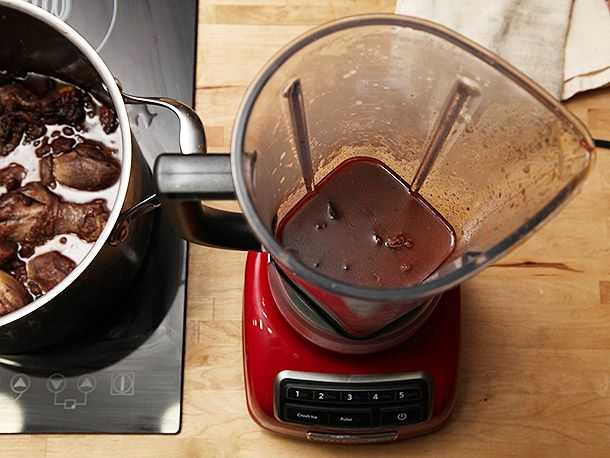 Blending part of the black bean soup in a countertop blender.