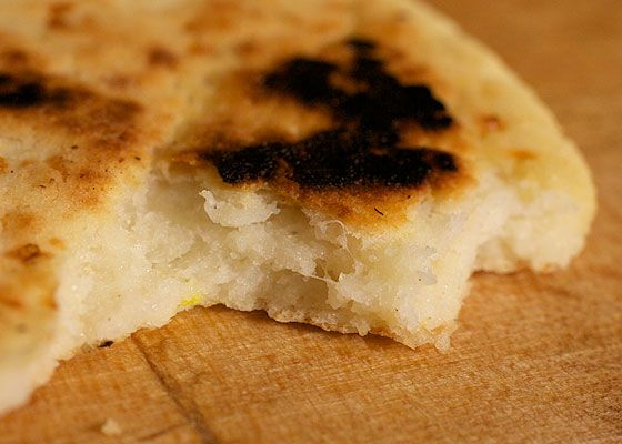 The inside of an arepa after a bite has been taken.
