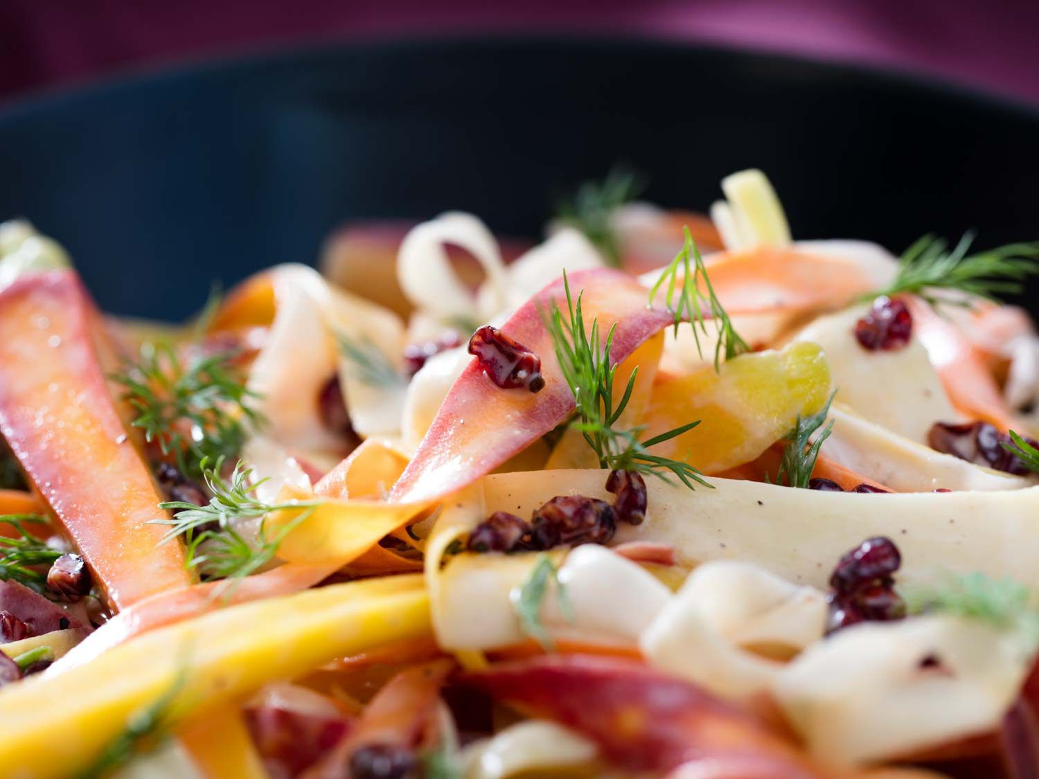 close up of carrot salad with ghee, yogurt, and barberry dressing