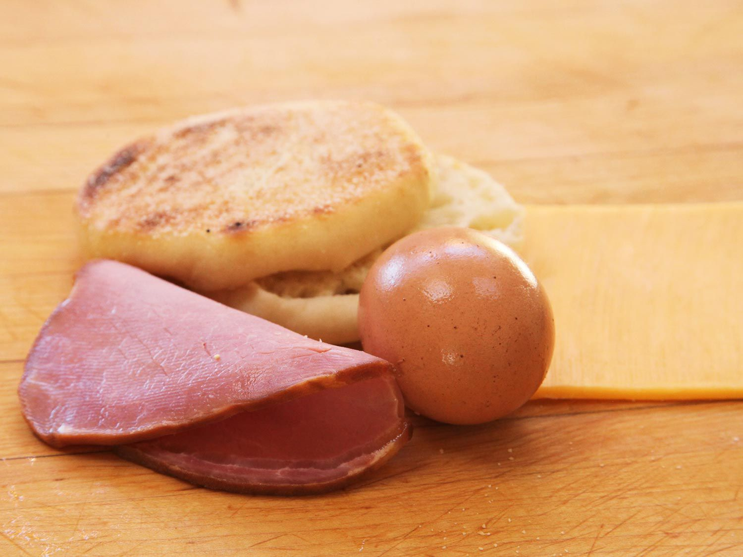 Copycat Egg McMuffin ingredients: an English muffin, Canadian bacon and an egg