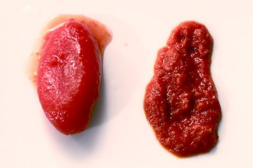 Photo showing the difference between a whole canned tomato and canned tomato purée.