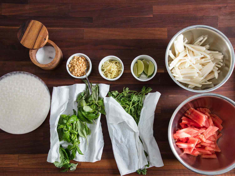Rice paper wrappers, watermelon matchsticks, jicama matchsticks, chopped peanuts, ginger, herbs