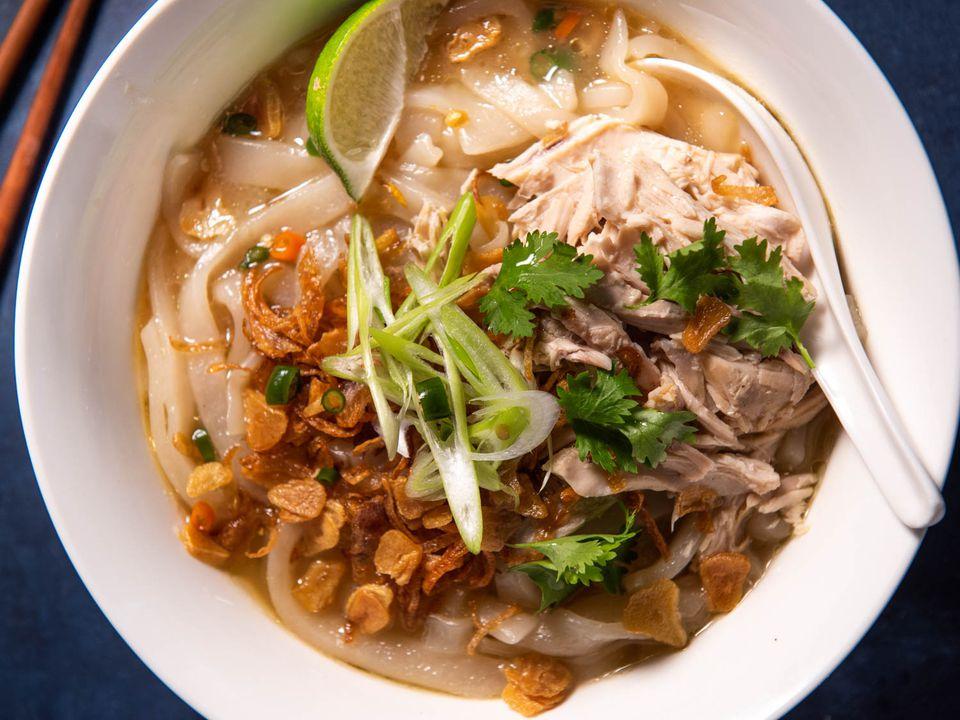 Bowl of khao piak sen (Lao chicken noodle soup)