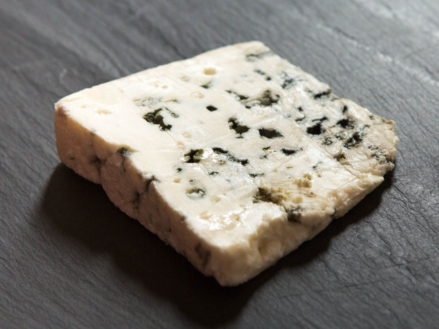 a wedge of Roquefort cheese.