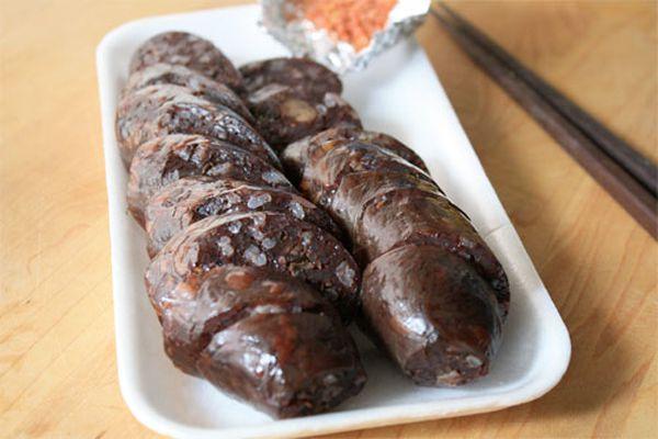 Korean blood sausages sliced on a rectangular white plate.