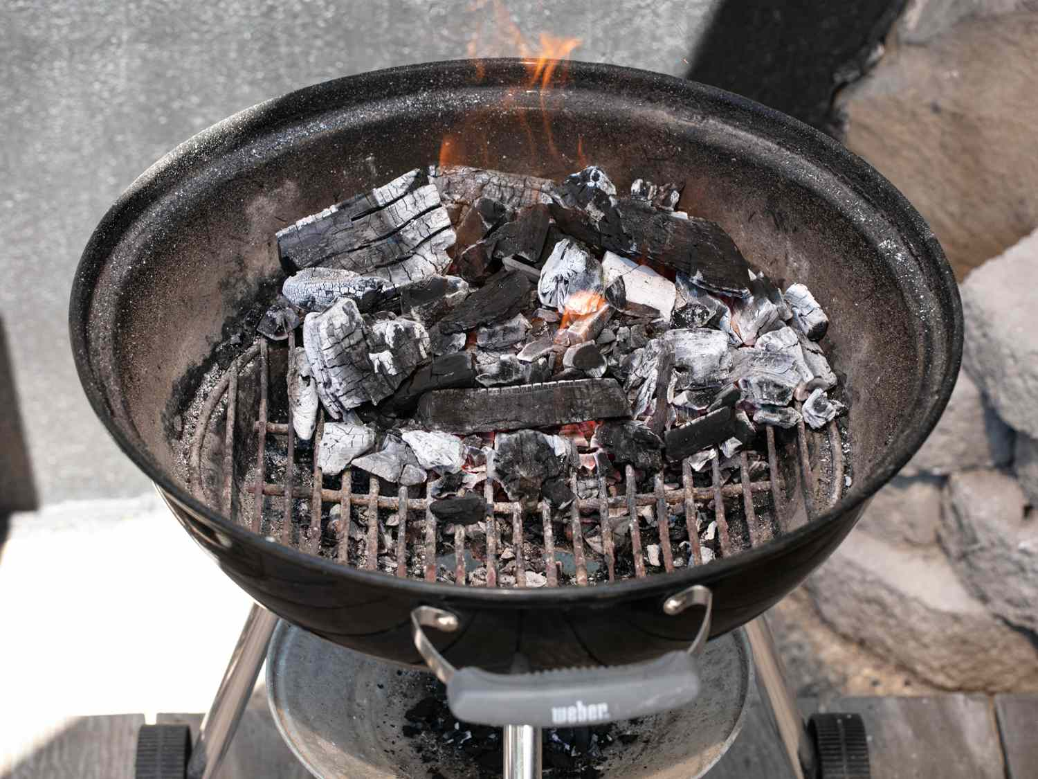 charcoal added to kettle of grill