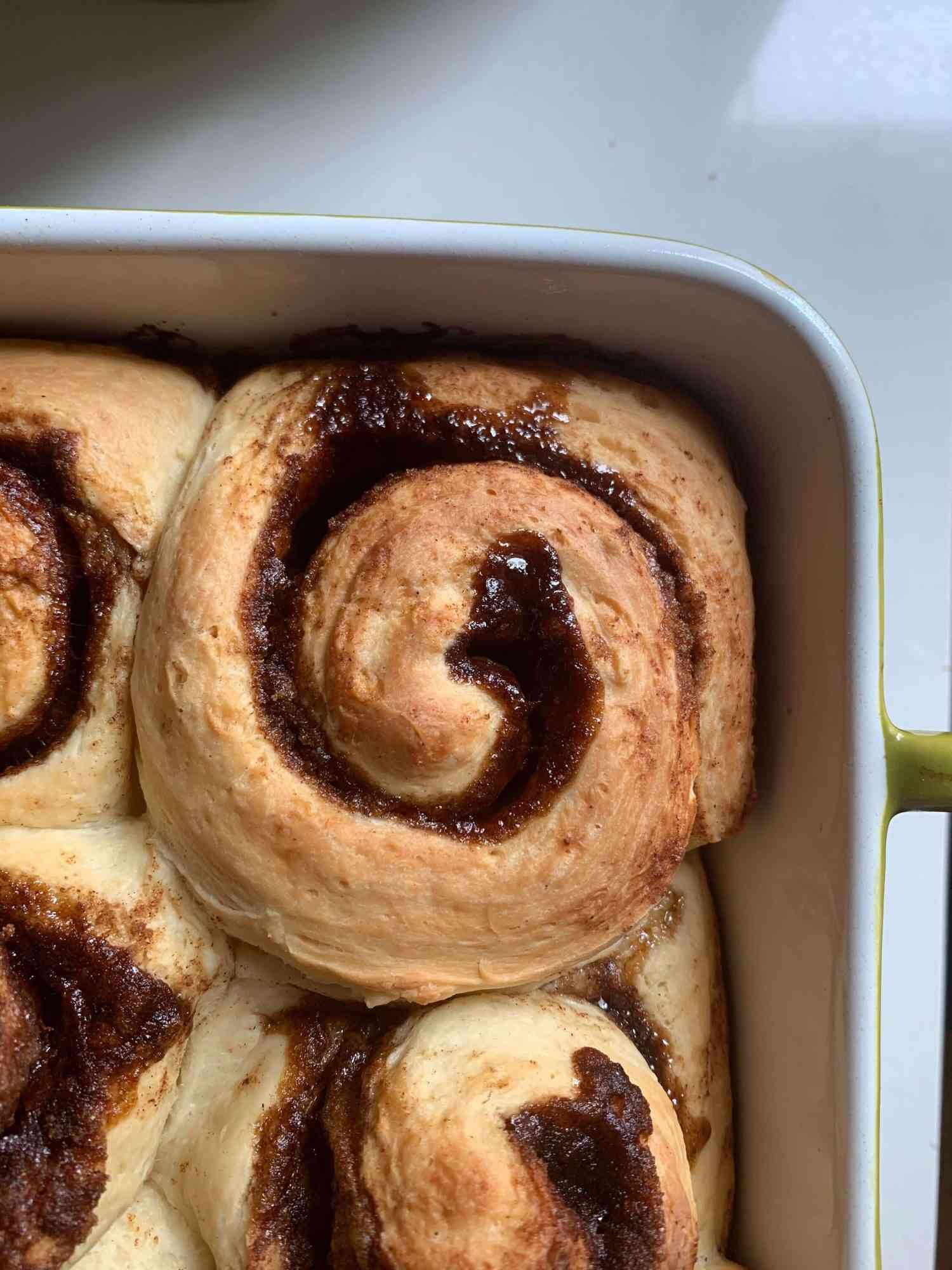 cinnamon buns in a caking dish, pre glazing