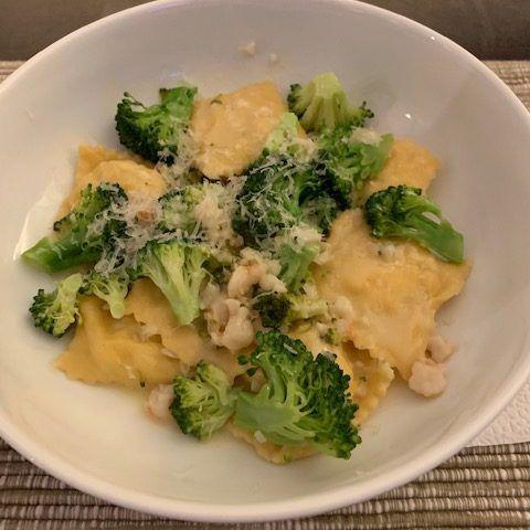 ricotta ravioli in a bowl with broccoli