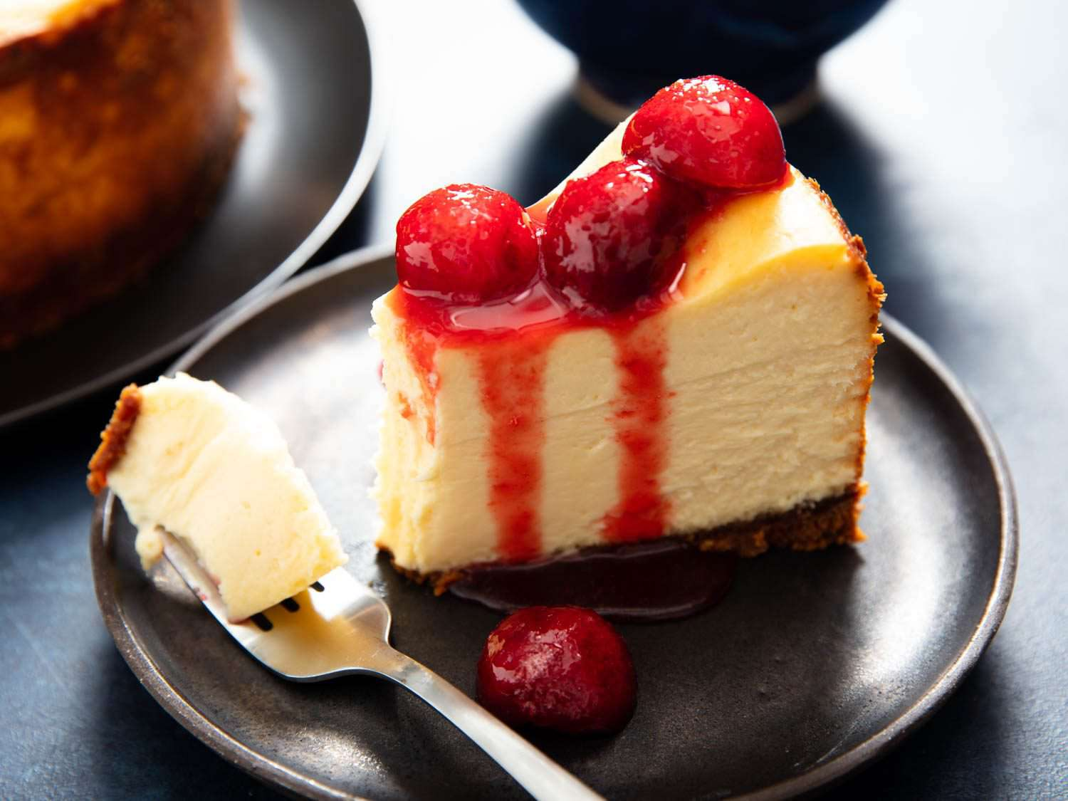 massive slice of cheesecake with a bite on a fork