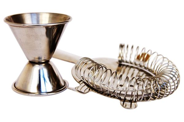 A cocktail jigger and a strainer.