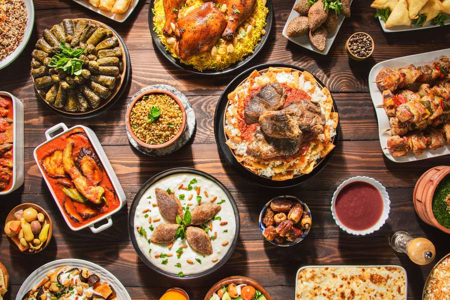 Overhead view of a table full of traditional Ramadan foods.