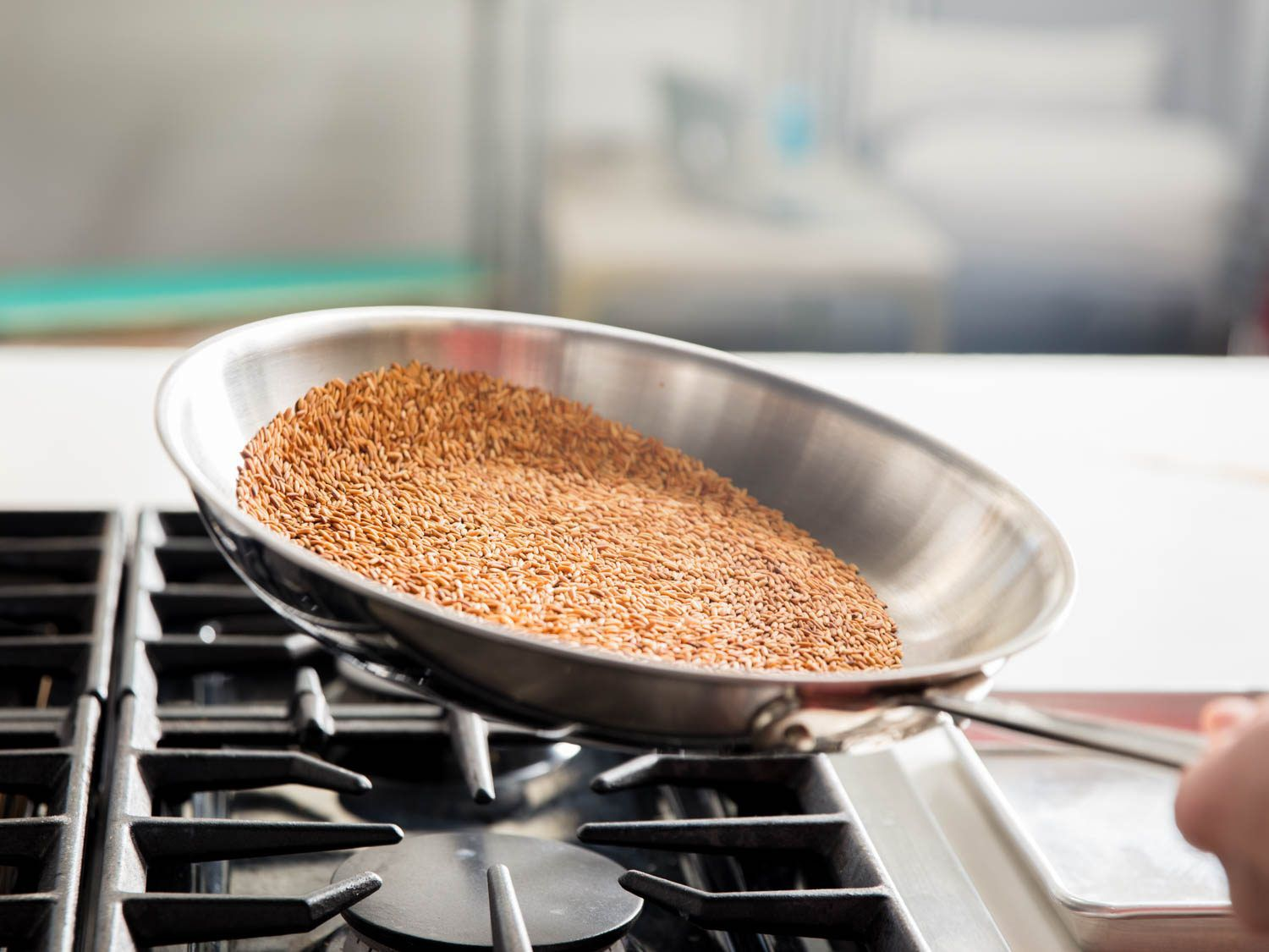 Tossing toasted rice in a skillet