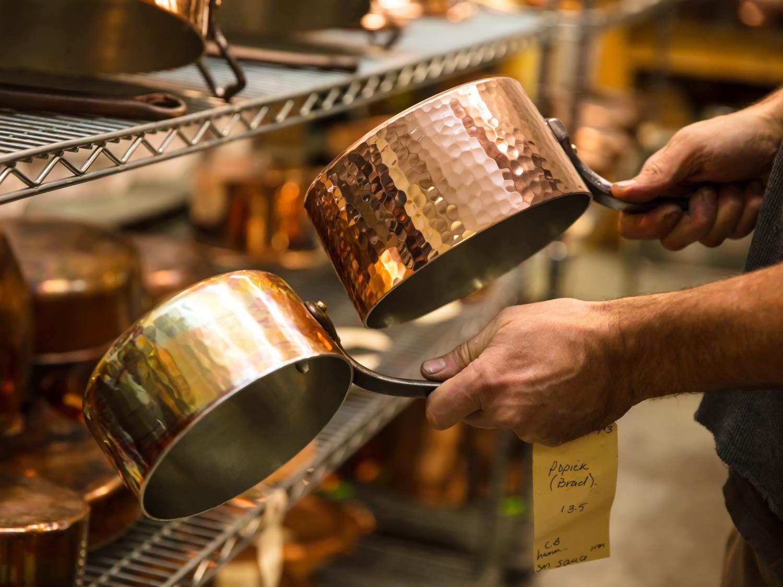 Hand hammered and spun copper saucepans