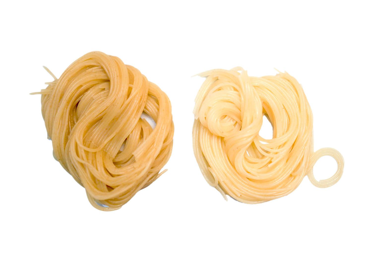 Side by side comparison of angel hair pasta cooked with baking soda and without. The pasta cooked with baking soda has a deeper yellow color.