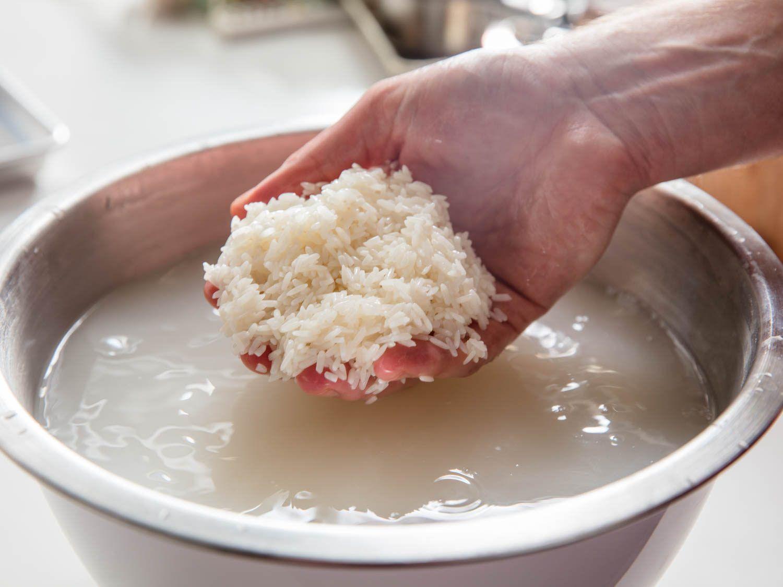Soaking glutinous rice prior to cooking.