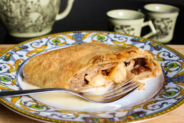 Apple strudel on a plate with a fork.