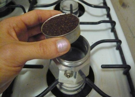 Adding ground coffee to Moka pot