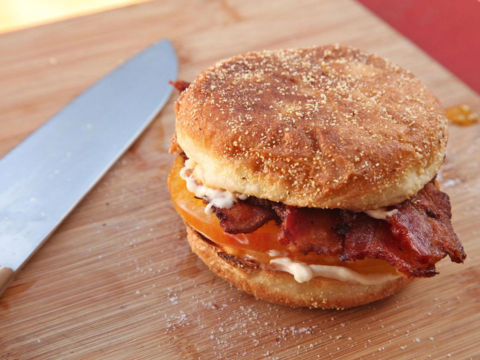 tomato and bacon breakfast sandwich on English muffin