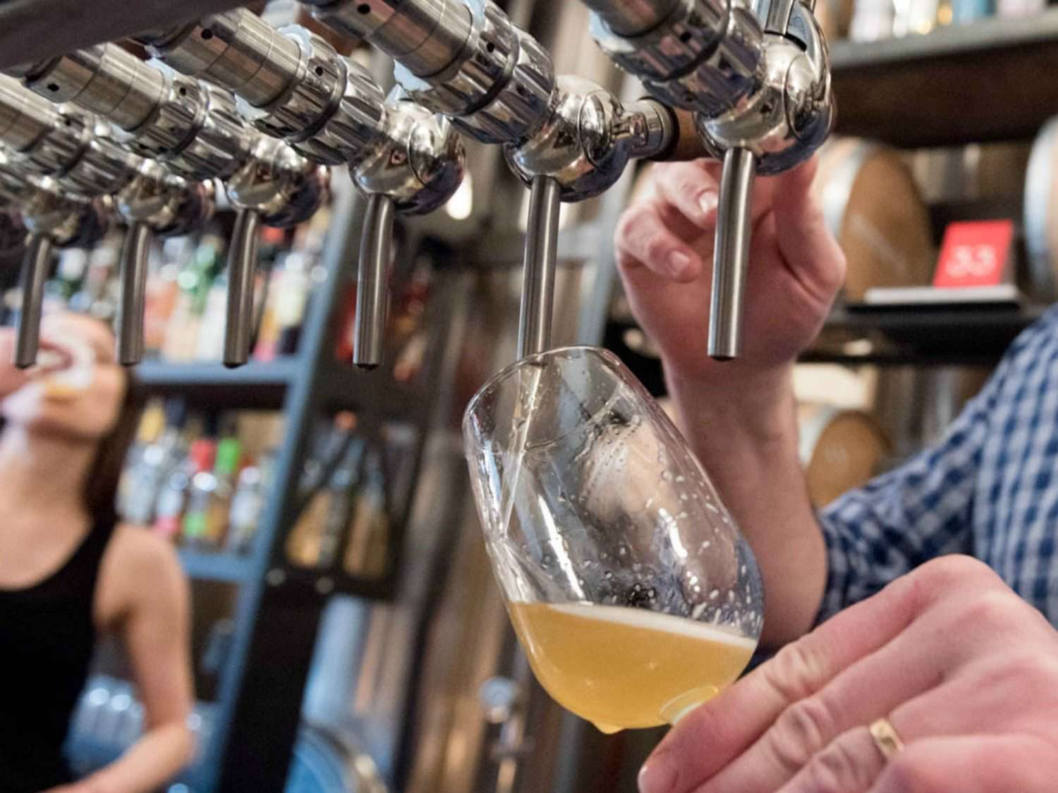 Pouring beer into a glass from a tap.