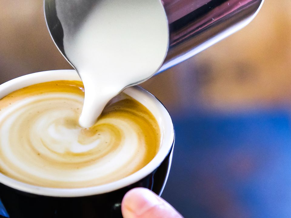 a close up of a latte being made with a non-dairy milk