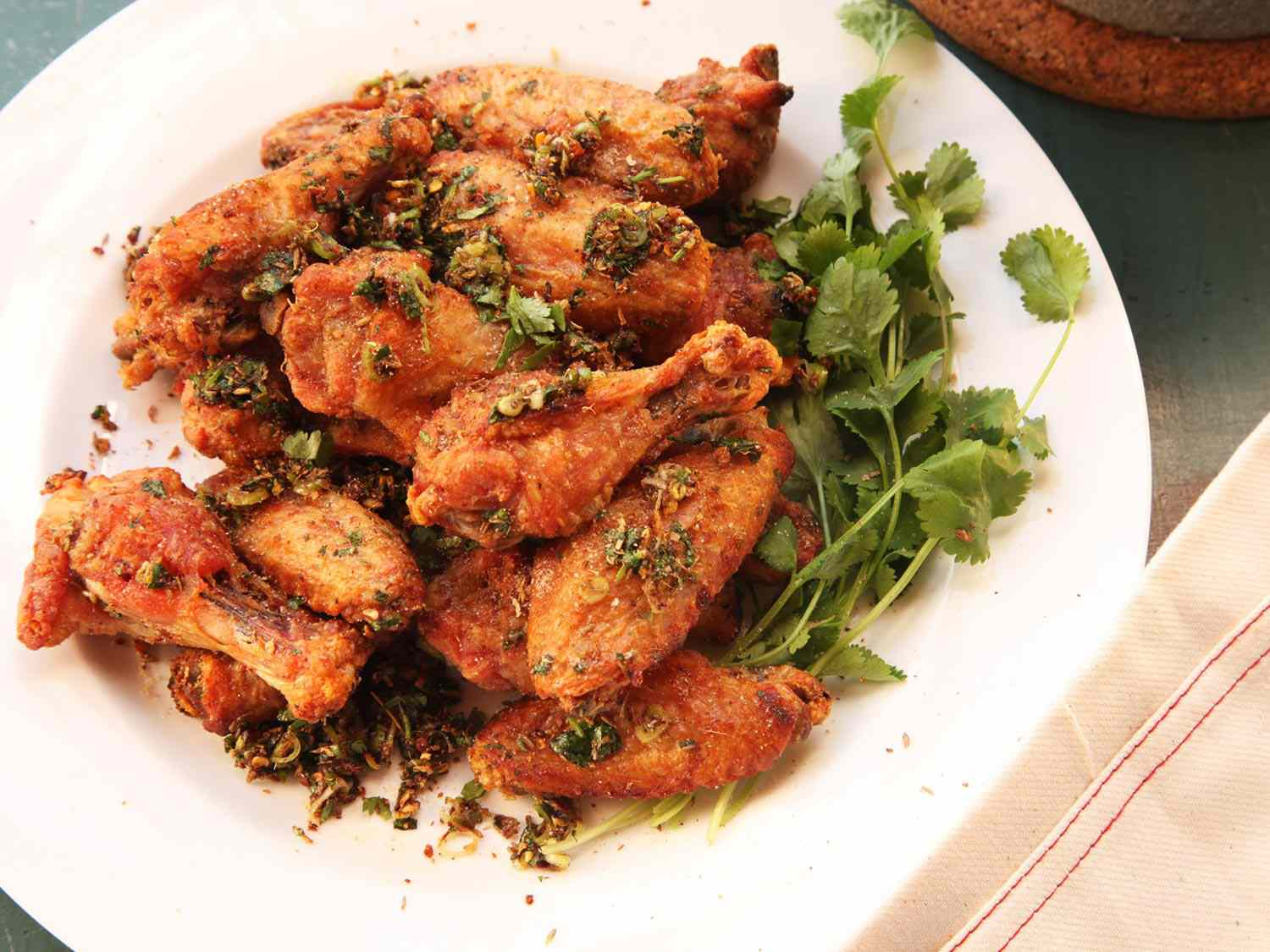 A plate of oven-fried chicken wings spiced with chili, cumin, and anise
