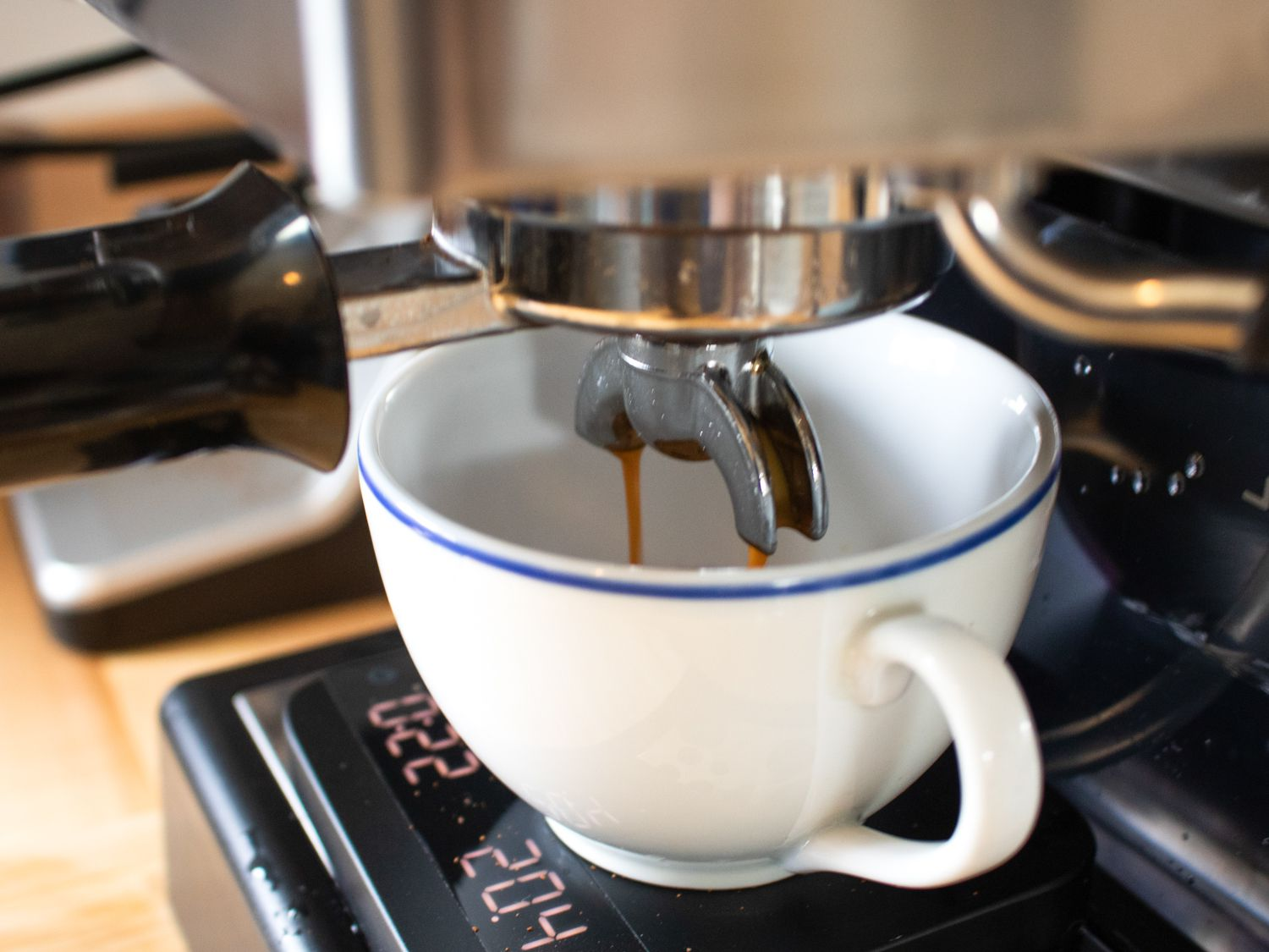 An espresso shot being pulled from the Gaggia Classic Pro espresso machine